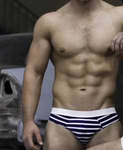 Sportive Swim Briefs With Navy Strips And White Band. Made From a Mix of Poliamide and Lycra. Low & Sexy Cut. Perfect Adjustment. Fit to Your Body Perfectly Thanks to Our Special Cut and Shape.