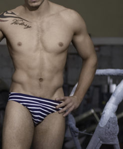Sportive Swim Briefs With Navy Strips. Made From a Mix of Poliamide and Lycra. Low & Sexy Cut. Perfect Adjustment. Fit to Your Body Perfectly Thanks to Our Special Cut and Shape.